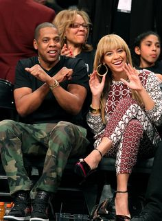 Generally being adorable with Jay Z in a matching set while courtside.