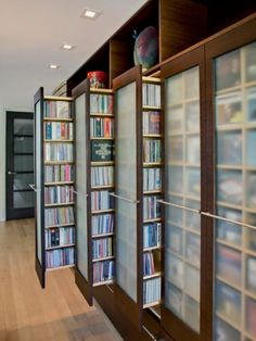 These would be amazing. Floor would be nice and open, the books are still easily accessible but cleaner, and they could all be great facades for posters/kid's art.