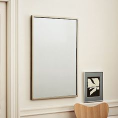 "• Overall product dimensions: 24""w x 1.75""d x 36""h. • Frame width: 2"". • Mirror surface: 22""w x 34""h.  $199"