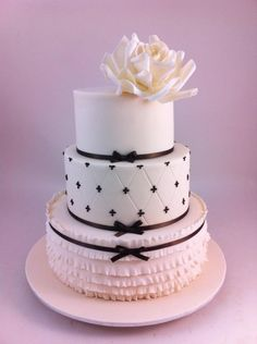 Three Tier Wedding Cake with ruffles, quilting and a giant sugar rose