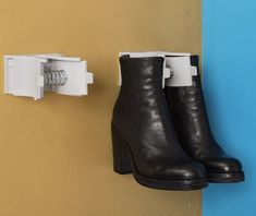 Ambos Boot Hanger can be installed on walls (shown here) or under shelves.  Hanging your books like this helps prolong their life, avoiding the sides from folding down and creasing. Each unit holds a pair of boots.