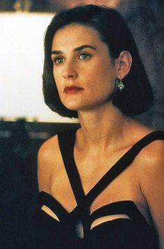 """The most famous dress of the designed by Thierry Mugler for Demi Moore in the film """"Indecent Proposal"""" also starring Robert Redford. After the movie, all fashionistas wanted this dress and tried to get one! It remained a hallmark of the Indecent Proposal, Maggie Cheung, Celebrity Prom Dresses, Julie Christie, Mia Farrow, Actrices Hollywood, Robert Redford, Diana Ross, Thierry Mugler"""