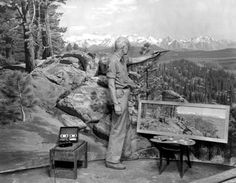 James Perry Wilson paints the background of the Jeffrey Pine Forest diorama in the Hall of North American Forests, 1956.