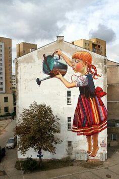 girl watering tree street art grafitti - love this!
