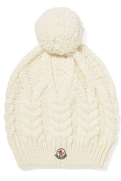 Moncler's ivory beanie is a stylish choice whether you're hitting the slopes or relaxing après-ski. This classic cable-knit design is spun with touches of wool and alpaca and topped with a fuzzy pompom. Team it with a cozy turtleneck.