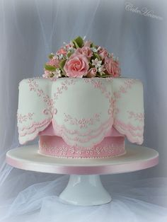 scalloped edged topped with pink roses....