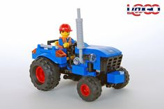 Custom LEGO Road Repair Tractor. A modern interpretation of the classic set 6647, Highway Repair from 1980. The tractor itself is a relatively simple, 6-wide design, with a 3-wide nose.
