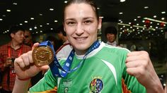 Katie Taylor displays her gold medal in China