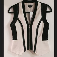 """Kirstie Contrast Vest NWT.  Impeccable ponte vest detailed by flawless faux leather-trimmed colorblock insets, plus precision seaming and topstitching. Chic embroidery adds a beautiful handworked charm. Goldtone zip closure. Fully lined. 66% Rayon, 30% nylon, 4% spandex Hand wash Imported Center back to hem: 18.5"""" (47 cm) Model is 5'10"""" and wears a US size 6 NO TRADES PLEASE bebe Tops"""
