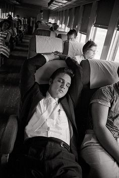 July 3, 1956, Elvis on a train headed to Memphis where He will perform at Russwood Park on July 4, 1956.