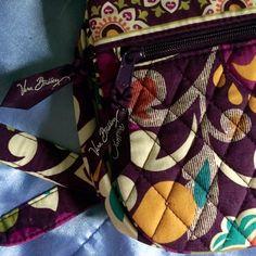 Vera Bradley Purse Purple Vera Bradley purse. Has zipper pocket, button pocket, and smaller zipper pocket on outside. Adjustable strap. Never used. Vera Bradley Bags Satchels