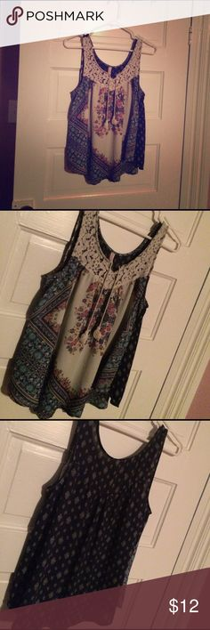 Floral tanktop Very pretty tanktop with floral design and lace detail around neck. Has two tassels in front. Flowy and light, perfect for summer or spring. Great condition. ☺ Xhilaration Tops Tank Tops