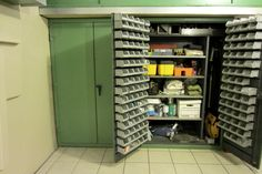Inexpensive Harbor Freight bins hold fasteners inside the doors of a Strong Hold Cabinet.