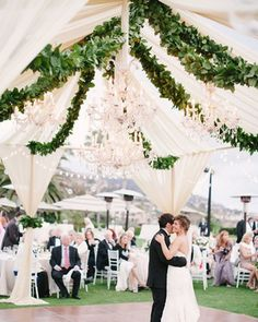 Decorate an open tent with chandeliers and garlands of greenery like this for a romantic look ~ Amber Event Production