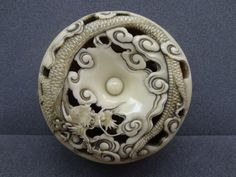 .Netsuke (manju). Dragon in clouds. Made of ivory. Made by: Hakuman - Japan