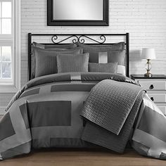 Grey king sized bedding gives a room a neutral setting in which one can add beautiful accent pieces. King & Queen Home Modern Frame Microfiber Lacquer 5 Piece Comforter Set (Queen)