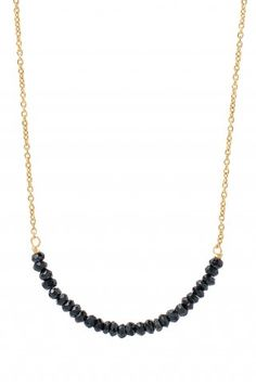 """Faceted black spinel beads line up neatly on a gold vermeil chain.     1 3/4"""" of stones, 7 1/2"""" of chain on each side with 2"""" extender. Lobster clasp closure"""