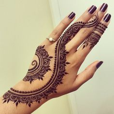 Curvylicious: Modern minimalism meets classic beauty in this mehndi design. Twisting up the wrist and hand, it tells its own story while giving space for a stunning manicure to be showcased. Thanks to Divya's steady hands, posted originally here.     You might also like Indian Mehndi Design – The Crafted Cuffs Bengali Mehndi Design …