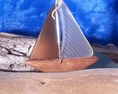 Sea Glass Sailboats made by Geoff Goodman using AUTHENTIC glass that he and his wife April collect along the shores of Maryland's Chesapeake Bay. See Etsy for more pieces!