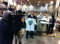 Milwaukee ABC affiliate WISN 12 camera crew filming a location spot about Ink to the People still printing Boston Strong shirts, and ultimately helping raise one million dollars for the One Fund.