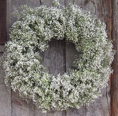 I love baby's breath and like to use it for everything. This would look amazing against our maroon front door.