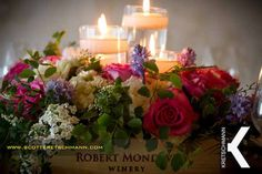 Ambiance Floral, flowers and candles set in a wine box for a wedding centerpiece