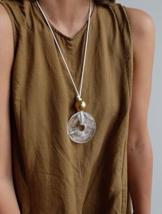 Crystal quartz donut and brass oversized pendant from Diameter NYC. Silver Pendant Necklace, Diy Necklace, Leather Necklace, Leather Jewelry, Necklace Designs, Coin Jewelry, Jewelry Crafts, Beaded Jewelry, Jewelery