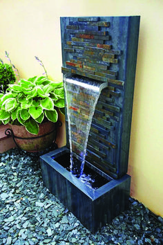 30 Best DIY Water Fountains Photos Few elements in any garden manage to elicit the same appreciation as a well-placed water feature. It conjures alleviate and can tie together an entire Indoor Water Features, Small Water Features, Water Features In The Garden, Backyard Water Feature, Ponds Backyard, Backyard Landscaping, Backyard Patio, Landscaping Ideas, Backyard Waterfalls