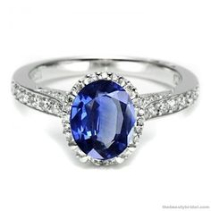 Google Image Result for http://thebeautybridal.com/wp-content/uploads/2010/11/kate-middleton-prince-william-diamond-sapphire-engagement-ring-tacori.jpg
