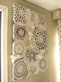 This appears to be doilies that are decopaged onto a canvas. Interesting way to display family heirloom items. I like this.   Photo From the Facebook page of Katie Beach Whitaker