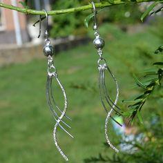 Elegante lange zilveren oorbellen