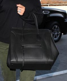 f1563499ac48 Khloe Kardashian was spotted at LAX carrying the Celine black Phantom bag  as she headed out of Los Angeles. Khloe is known for carrying the
