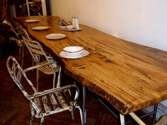 love the dining table, reminds me of a George Nakashima table...but not as good