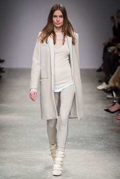 Complete ensemble look in stone. Translucent tunic top with leggings and strappy high ankle booties. Topped with  a knee length open coat with two straight pockets and two flap pockets above. High style. Style Planet | Isabel Marant Fall 2013