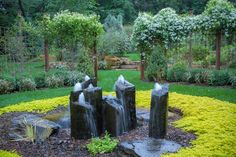 Basalt column rock fountains surrounded by Creeping Jenny