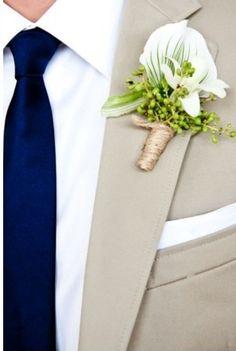 grey suit and navy tie