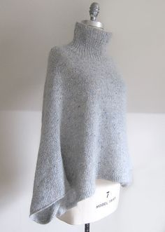 Mayu is an easy to wear pullover that is perhaps best described as a stylish poncho with sleeves. The tweediness of the Fine Donegal and the soft halo of the Silk Cloud combine to create a beautiful fabric that is both slightly rustic and decidedly sophis Poncho Knitting Patterns, Knitted Poncho, Knitted Shawls, Knit Patterns, Free Knitting, Knitted Cape Pattern, Poncho Sweater, Poncho With Sleeves, Handgestrickte Pullover