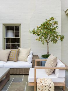 40 Chic Ideas for Patios and Porches on a Budget | HGTV Outdoor Curtains, Outdoor Sofa, Outdoor Living, Outdoor Decor, Outdoor Patios, Small Outdoor Spaces, Small Patio, Outdoor Areas, Outdoor Rooms