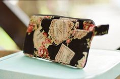 collage style clutch bag floral decorated cotton by berriesDot