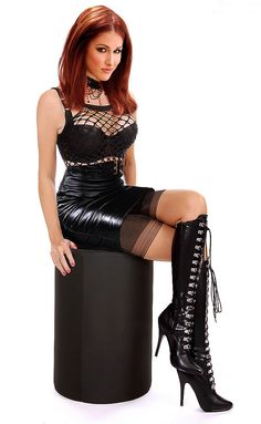 Shiny redhead in vinyl-leather skirt and lovely boots