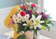 flower arrangement in a mixer for a kitchen-themed shower