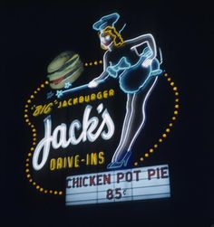 "In 1944 it was one of several Dolores' Drive-Ins in the Southland. By 1952, it was Jack's Drive-Ins [the plural is sic], home of the ""Big"" Jackburger, and this remarkable polyglot sign comprised of sculpted backlit plastic, sinuous neon tubing and incandescent lights."