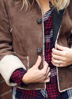 Cropped shearling jacket and plaid shirt.