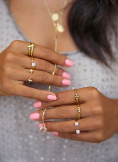 Golden rings and pink nail polish