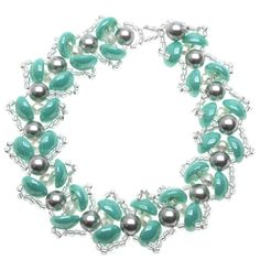 Looking like cascading petals, Czech Glass piggy beads overlap and surround a SWAROVSKI ELEMENTS crystal faux pearl in the bead woven Water Lily Bracelet. The design is intricate, fetching and feminine.