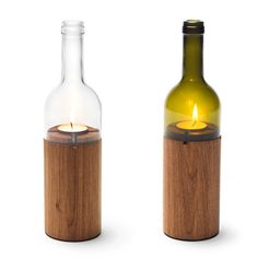 delicate wine bottle hurricanes resting on  beautiful wooden tea light holders