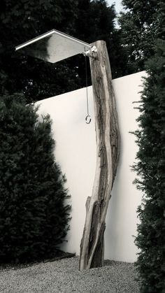 outdoor shower made with tree trunk