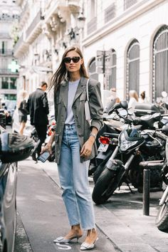 We all love to make a statement but sometimes it comes time for inspiration for your everyday looks. This street style look from Giorgia Tordini is foolproof and polished with a gray blazer, lighted gray t-shirt, vintage straight leg denim, and a pair of
