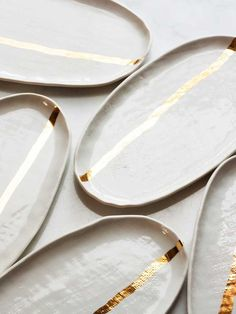 beautiful handmade ceramic plates with gold stripe from suite one studio