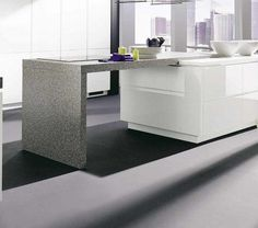 Grey table top with white cupboards and dark floor tiles